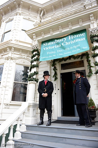 President of the Stansbury Home Preservation Association Dino Corbin, left, and Byron McLaughlin, right, stand outside the home Saturday, Dec. 5, 2015, during the Stansbury Home Victorian Christmas annual fundraiser in Chico, California. (Dan Reidel -- Enterprise-Record)