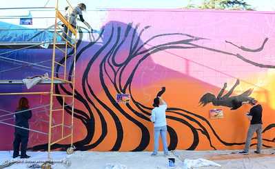Fifth Sun artists, left to right, Karen Riedler, Lori Escobar, Darrell Evans and Erik Vickner work Friday, Dec. 4, 2015, on a mural at the Boys and Girls Club in Chico, California. (Dan Reidel -- Enterprise-Record)