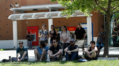 A group watches as Hashtag YEAH performs during the lunch time Nooner Wednesday April 20, 2016 in the Trinity Commons at Chico State in Chico, Calif. Associated Student Productions features a new band each Wednesday as part of the April Nooner series. (Emily Bertolino -- Enterprise-Record)
