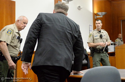 Former Paradise Police Officer Patrick Feaster, center, appears in Butte County Superior Court Friday April 22, 2016. Feaster, charged with manslaughter in a deadly police shooting, has waived his right to a preliminary hearing and will be rearraigned May 11. (Bill Husa -- Enterprise-Record)