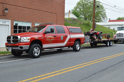 "Luray, Virginia's Chief 1 (Dodge) towing a Honda ATV and small trailer, ""Stokes 1""."