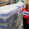 Palmetto Health Tuomey team members distributed cases of water during the flood.