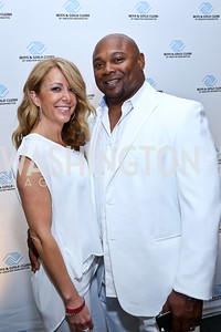 Marcy Blacken and Washington Redskins Director of Player Development Malcolm Blacken. Photo by Tony Powell. Pierre Garçon's 2nd annual All-White Charity Event. Millenium building rooftop. June 5, 2014