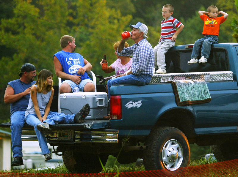 Three generations of lawnmower racing fans enjoy tailgating at a race in Dickson County.