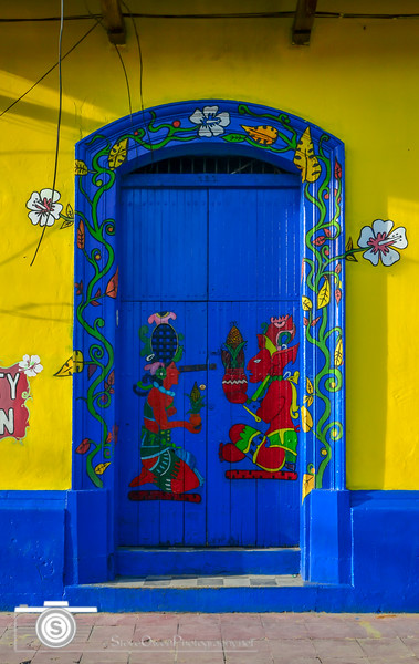 This is a door in Leon, Nicaragua. The bright colors and artsy motif just jumped out at me.