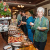 Bernadette Fideli and other Road Runners enjoying the pastries at the Keeter Center brunch..
