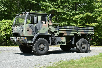 "SERV 5 (Special Emergency Response Vehicle) as photographed in July of 2017 while being prepared for service at Castleton, VA in Rappahannock County.  SERV 5 is a 1993 Steward & Stevenson Services M1078 2.5 ton.  It was received in 2017 from Ft. Bragg, NC through the VA Forestry Department.  In the military, it was a troop carrier and performed other duties as well.  SERV 5 can drive through water up to 48"" and has a 125' winch cable, capable of being used on the front and rear of the truck.  The plans are to have a HMA wildland skid unit added, a booster reel, 2,000 pound small crane for stokes operations, and a canvass area just behind the cab for EMS, and a snow plow."