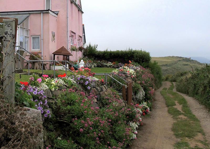 A beautiful garden border adds a splash of colour.