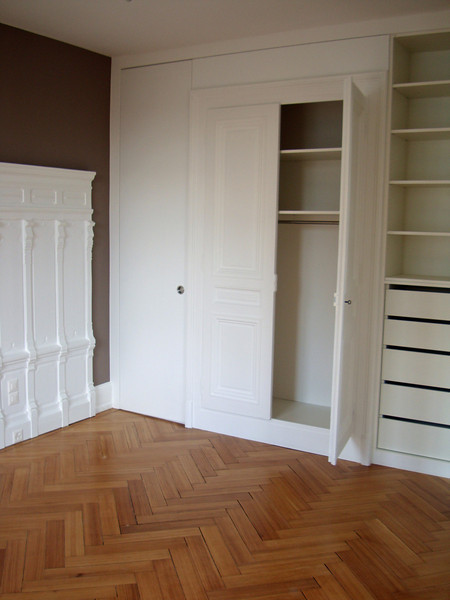 Master bedroom: two old closets in the centre and modern ones built on each side of it. The panelling on left came from the wall in the old dining room.