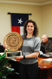 Junior high principal, Mrs. Leah Bobbitt,  accepts plaque for her campus, staff and students.