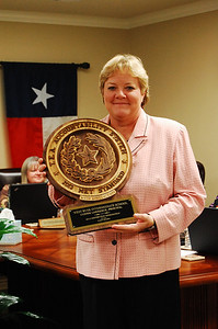 Intermediate campus principal, Ms. Connie Lawrence,  accepts plaque for her campus, staff and students.