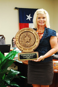 Elementary Campus Principal Dr. Michelle Cline accepts plaque for her campus, staff and students.