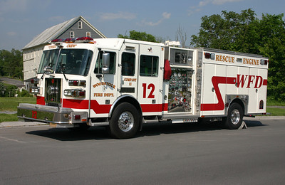 Woodstock's Rescue Engine 12, a 2007 Sutphen 1500/750/30A with serial number HS-4167.  Photographed in May of 2012 with a group of Virginia firefighters visiting Station 12.