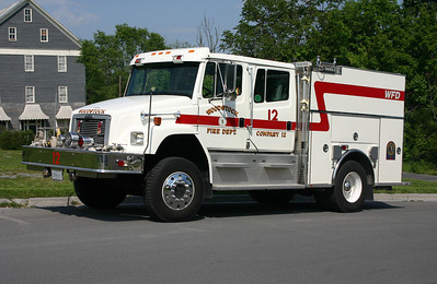 Woodstock's Engine 12 is this unique 1996 Freightliner 80 and built by Boise Mobile Equipment.  Equipped with a 1000/500/40 and is designed as a wildland interface truck.  Photographed in May of 2012.