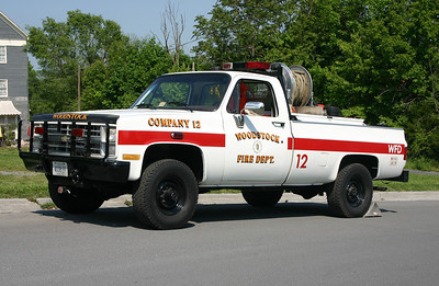 Woodstock's former Brush 12, a 1986 Chevrolet with a 2002 CET skid unit and equipped with a 100/150.  An old military truck, and modified by the military in 1992.  Original military, and then acquired by the Virginia Department of Forestry before going to Woodstock.  Photographed in May of 2012.  Returned to the Dept. of Forestry when the new Brush 12 was delivered.