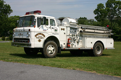 "Woodstock's old 1965 Ford C850/John Bean 750/500 with serial number 75A9-SF10-9.  Originally Woodstock, and eventually sold to Capon Bridge, West Virginia in Hampshire County.  It was then sold to a Construction Company owner in Capon Bridge, and he named it ""For The Kids"" for his kids.  In 2012, it was obtained by Keplinger Repair, and is currently kept at the Candy Hill camp ground in Winchester, Virginia."