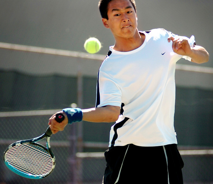 Westlake High's Michael Chang focuses on the ball during a doubles match against Newbury Park High.