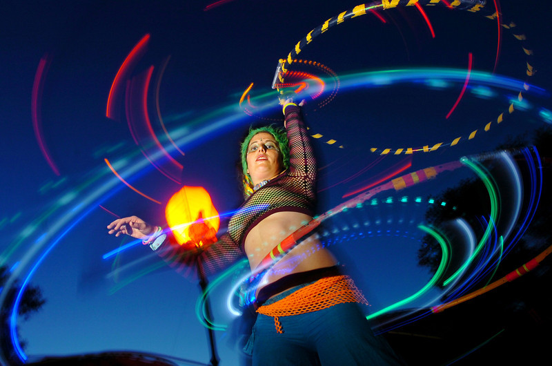 Jamie Luv of San Francisco shows off her hula hooping skills by spinning two LED-illuminated hoops at the same time while dancing to music at the Woogie Stage during the 2007 Lightning in a Bottle festival in Santa Barbara County.