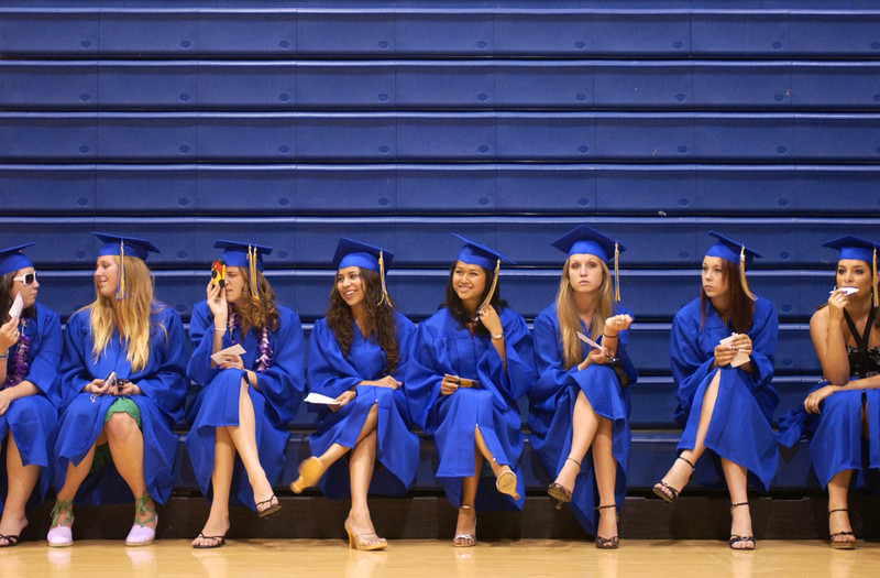 Nordhoff High School graduates took shelter inside the gymnasium to escape the afternoon heat as they waited to file into to the stadium for commencement.