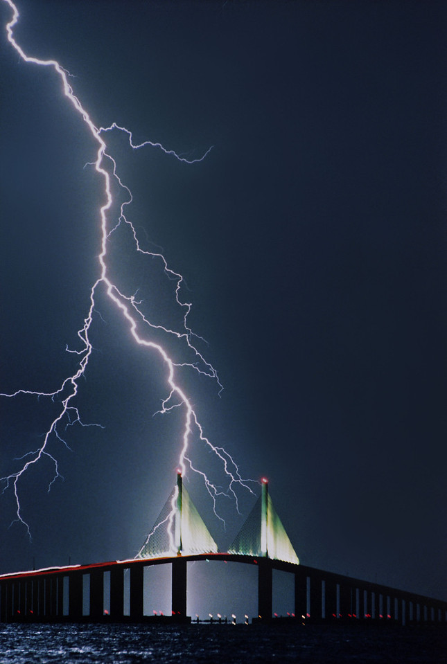 Lightning strikes the Sunshine Skyway Bridge in St. Petersburg, Florida, during a summer thunderstorm.