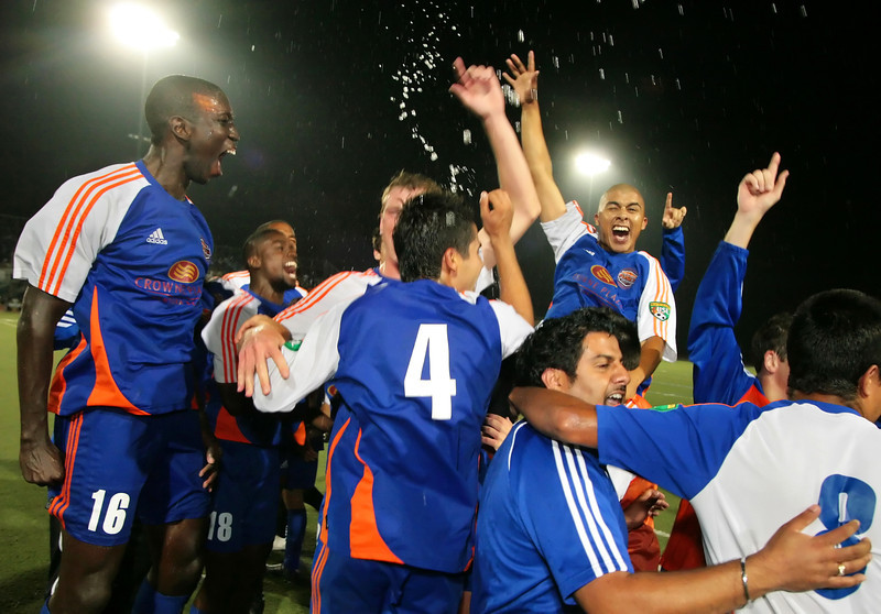 The Ventura County Fusion USL soccer team celebrates winning its first ever PDL Championship title in 2009 after defeating Chicago Fire Premier in Ventura.  After starting their 2009 season slowly the Fusion sneaked into the playoffs as the lowest seed in the West but went on to win the title game by one goal in injury time.