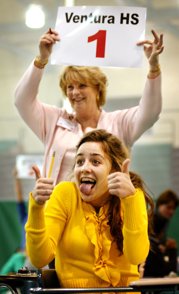 Ventura High School senior Jocelyn Christie couldn't contain her excitement as Fran Madison-Cohee showed her score following a correct answer during Super Quiz Oral Relay of the Ventura County Academic Decathalon at Pacifica High School.
