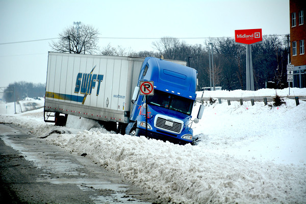 One semi was stuck in a ditch, just north of the Sigel on ramp to Interstate 57/70.
