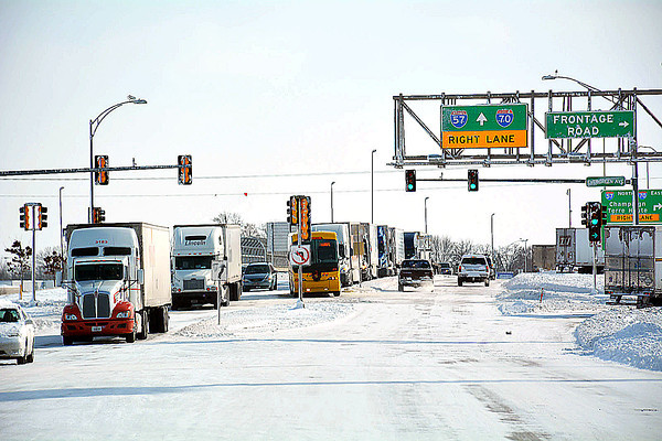 Semitrucks and trailers filled the Keller Drive off-ramp on Monday afternoon as road conditions were difficult for travel.