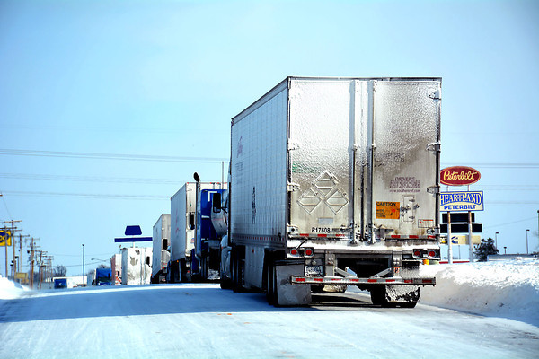 Effingham was inundated with semitrucks and trailers as interstate traffic was difficult after more than a foot of snow fell on Sunday and high winds blew on Monday.