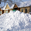 With over a foot of snow falling Sunday, plows piled snow high around the city Monday afternoon.