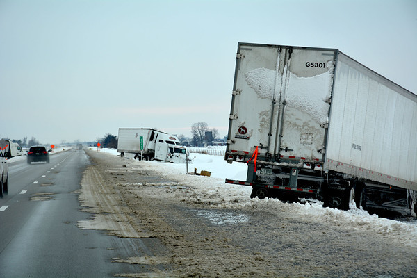 Snow and slush still fill lanes of traffic on Interstate 57, making towing increasingly difficult.