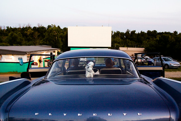 "Ken and Judy Smith, right, hang out in their 1958 Plymouth Plaza with their grandson, Hunter Leidolf, 10, while waiting for the film ""Dawn of the Planet of the Apes"" to begin on screen one at the Georgetown Drive-In. Staff photo by Christopher Fryer"