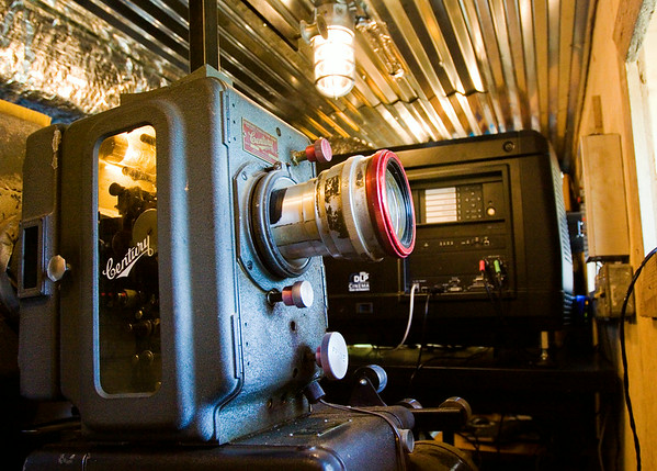 A Century 35mm movie projector, left, is pictured next to a Barco digital movie projector in the screen one projection booth at the Georgetown Drive-In. Owner Bill Powell switched to digital projection in late June. Staff photo by Christopher Fryer