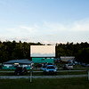 "Moviegoers park their vehicles before a showing of the film ""Dawn of the Planet of the Apes"" at the Georgetown Drive-In. Staff photo by Christopher Fryer"