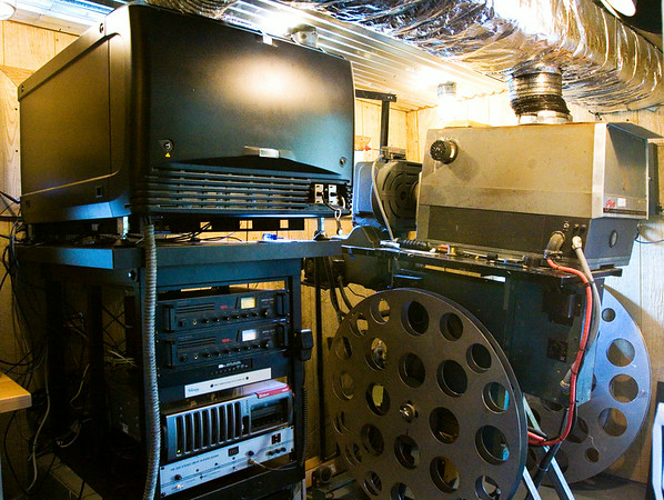 A Century 35mm movie projector, right, is pictured next to a Barco digital movie projector in the screen one projection booth at the Georgetown Drive-In. Owner Bill Powell switched to digital projection in late June. Staff photo by Christopher Fryer