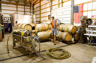 Owner and operator Jim Pfeiffer preps for the filtering process in the wine production area at Turtle Run Winery near Lanesville in Harrison County. The award-winning winery is in its 13th year of operation, and is one of four local wineries that will be showcased at Jeffersonville's Riverbreeze on Friday. Staff photo by Christopher Fryer