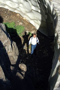 """This is the first year since I've been climbing that there has been snow drifts left from the previous winter. We estimated this """"solid ice block"""" of snow to be about 14 feet deep here where it is melting away next to a rock wall."""