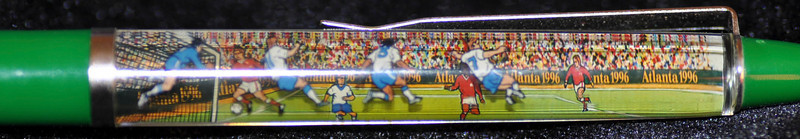 Back: site of 1996 Olympic Soccer, Athens Georgia <br /> Front: soccer game<br /> Floater: soccer players<br /> Style: Classic<br /> Color: green<br /> Cost: $6.00<br /> Category: sports