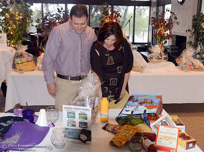 Matt Doyle (left) and Alison Doyle (right) browse the raffles for an organization raising money for Alzheimer's at the California Park Pavilion Saturday, September 21, 2013, in Chico, Calif. (Jason Halley/Chico Enterprise-Record)