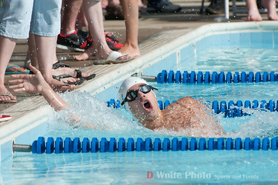 The winner of the boys 18 and under 50 meter backstroke from the North Lake Dolphins.