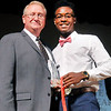 John P. Cleary | The Herald Bulletin <br /> Gary Coomer, of Pizza Hut, presented the overall Boys Athlete of the Year award to Jaien Webster of Anderson.
