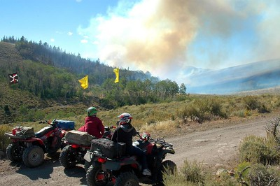 """We were a little concerned about riding this part of the trail because there were several fires. They were """"controlled burns"""", but we didn't see anyone there to keep them in check."""