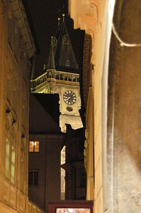 The top of the famous astronomical clock as seen from the narrow street that approaches St. Charles Square.