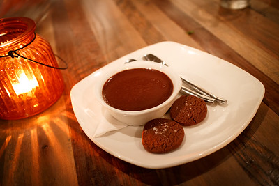 Chocolate pudding with chocolate shortbread cookies.