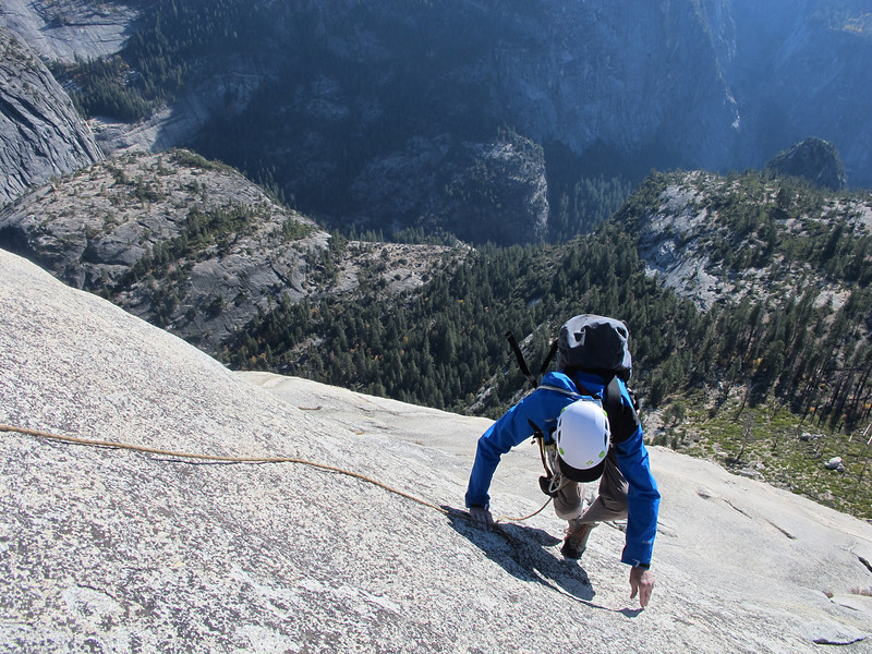 23/10/13 Chris coming up to the 5.2 roof on the last pitch of Snake Dike. Glacier Point and our campground far below. I'll leave it all to your imagination of what a 5.2 (Aussie grade 4!) roof looks like... Epic!
