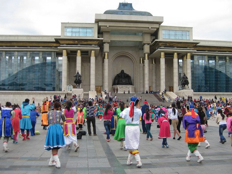Rehearsal for opening ceremony of Naadam festival in front of Ceremonial Hall (Parliament Building), Sukhbaatar Square.