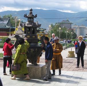 Honoring a shrine, clockwise rotation, at the Gandan monastery.