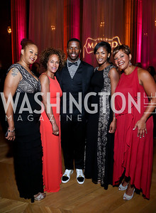 Thomasina Washington, Erika Martin, Redskins wide receiver, Josh Morgan, Dominique Taylor, Stacie Scott. Photo by Tony Powell. UNCF Masked Ball. Mellon Auditorium. March 27, 2014