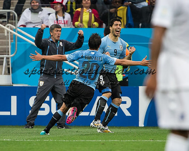 Uruguay players celebrate a goal.