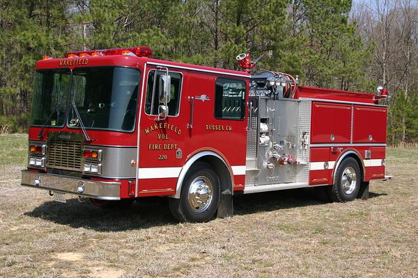 Engine 220 from Wakefield, Virginia is a 1991 Grumman FireCat top mount 1000/1000.  SN 18589.